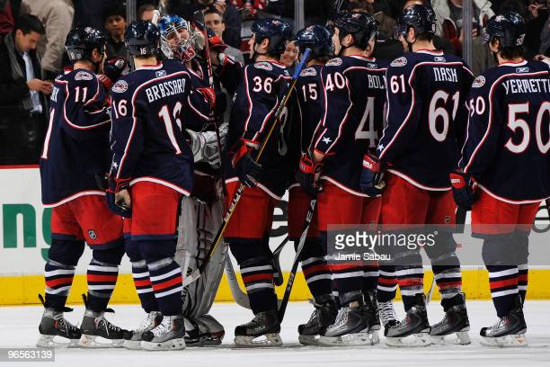 Goaltender Steve Mason of the Columbus Blue Jackets is congratulated by his teammates after he stopped 40 shots in a 30 shutout over the San Jose...