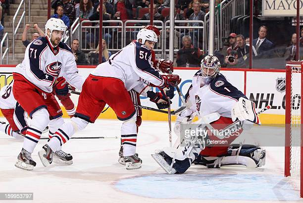Goaltender Steve Mason of the Columbus Blue Jackets looks back at the puck as it goes into the net on a goal scored by Steve Sullivan during the...