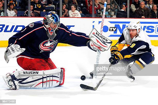 Goaltender Steve Mason of the Columbus Blue Jackets stops a shot from Derek Roy of the Buffalo Sabres during the third period on February 6 2010 at...