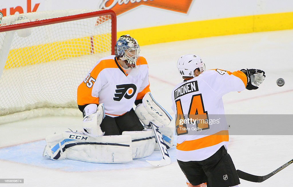 Goaltender Steve Mason #35 of the Philadelphia Flyers gets set in the crease as teammate Kimmo Timonen #44 tries to swat the puck away during third period action against the Winnipeg Jets at the MTS Centre on April 6, 2013 in Winnipeg, Manitoba, Canada.