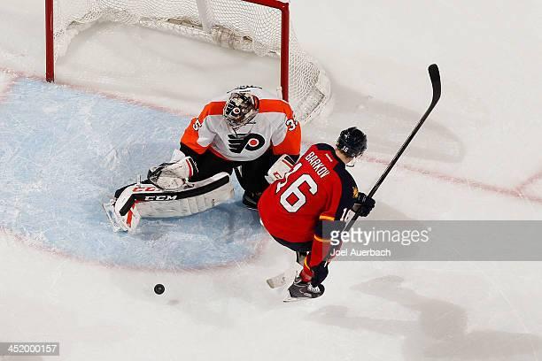 Goaltender Steve Mason of the Philadelphia Flyers stops a shot by Aleksander Barkov of the Florida Panthers at the BBT Center on November 25 2013 in...