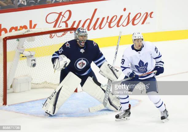 Goaltender Steve Mason of the Winnipeg Jets and Connor Brown of the Toronto Maple Leafs keep an eye on the play during second period action at the...