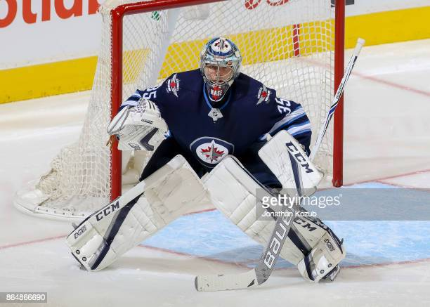 Goaltender Steve Mason of the Winnipeg Jets guards the net during second period action against the Columbus Blue Jackets at the Bell MTS Place on...