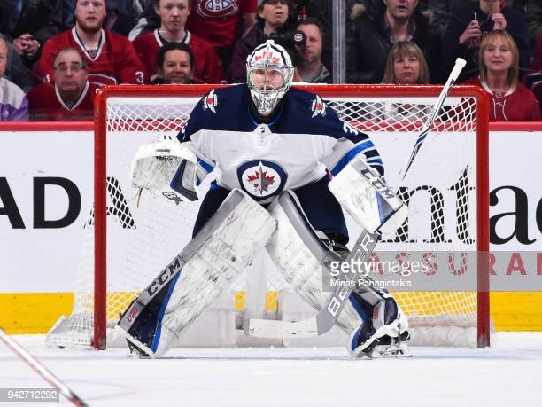 Goaltender Steve Mason of the Winnipeg Jets protects his net against the Montreal Canadiens during the NHL game at the Bell Centre on April 3 2018 in...