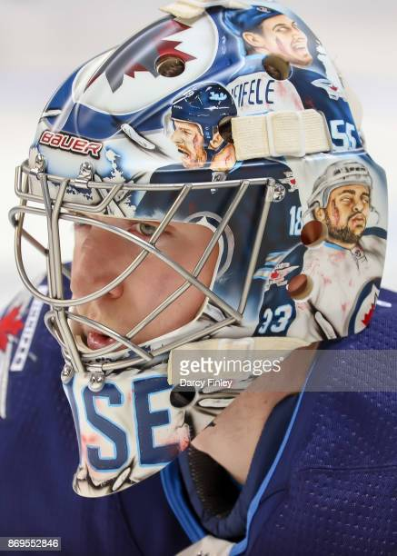Goaltender Steve Mason of the Winnipeg Jets sports a new zombie themed mask during the pregame warm up prior to NHL action against the Dallas Stars...