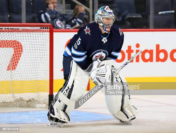 Goaltender Steve Mason of the Winnipeg Jets takes part in the pregame warm up prior to NHL action against the Toronto Maple Leafs at the Bell MTS...