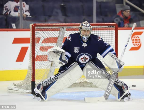 Goaltender Steve Mason of the Winnipeg Jets takes part in the pregame warm up prior to NHL action against the Arizona Coyotes at the Bell MTS Place...