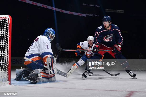 Goaltender Thomas Greiss of the New York Islanders blocks a shot taken by Josh Anderson of the Columbus Blue Jackets during the first period of a...