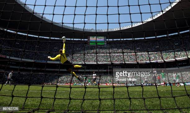 Goaltender Tim Howard of the USA goes up to block a goal by Israel Castro of Mexico during the FIFA World Cup Qualifying soccer match between the USA...