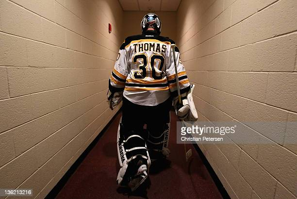 Goaltender Tim Thomas of the Boston Bruins walks back to the locker room before the NHL game against the Phoenix Coyotes at Jobingcom Arena on...