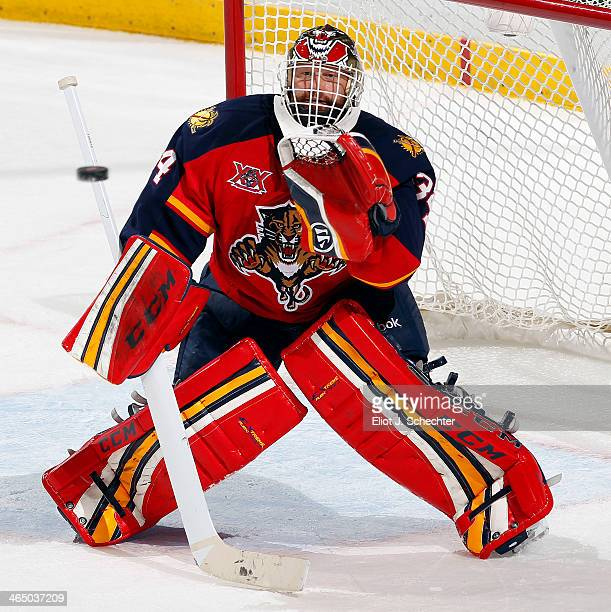 Goaltender Tim Thomas of the Florida Panthers defends the net against the New York Islanders at the BBT Center on January 14 2014 in Sunrise Florida