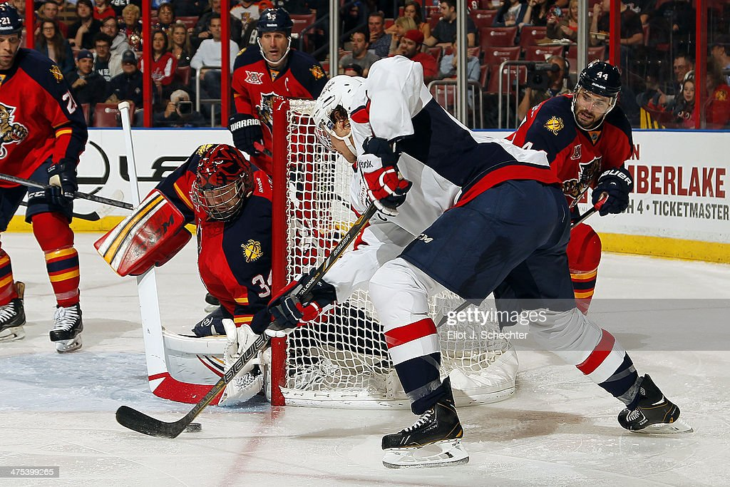 Goaltender Tim Thomas #34 of the Florida Panthers defends the net against Jay Beagle #83 of the Washington Capitals at the BB&T Center on February 27, 2014 in Sunrise, Florida.