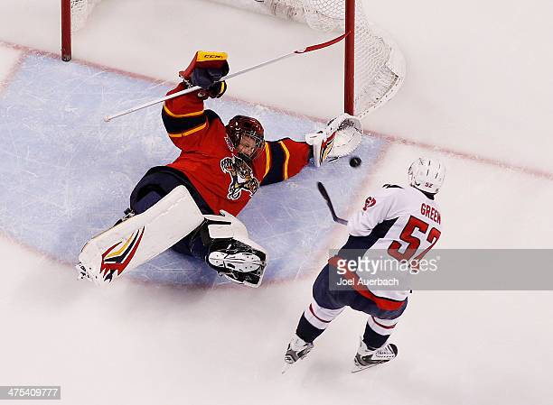 Goaltender Tim Thomas of the Florida Panthers stops a third period shot by Mike Green of the Washington Capital at the BBT Center on February 27 2014...