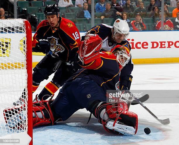 Goaltender Tomas Vokoun of the Florida Panthers defends the net with the help of teammate Shawn Matthias against Jim Slater of the Atlanta Thrashers...