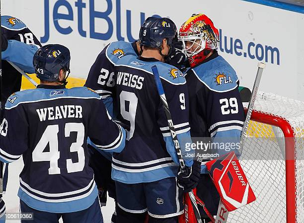Goaltender Tomas Vokoun of the Florida Panthers is congratulated by Steve Bernier and Stephen Weiss after the 60 victory against the Tampa Bay...