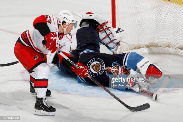 Goaltender Tomas Vokoun of the Florida Panthers stops a shot by Jeff Skinner of the Carolina Hurricanes on January 7 2011 at the BankAtlantic Center...