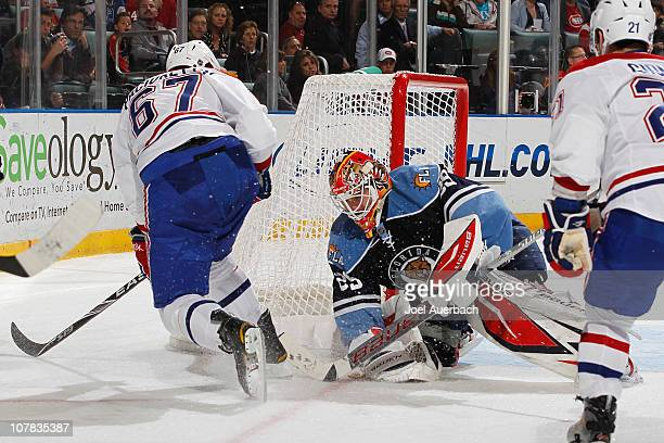 Goaltender Tomas Vokoun of the Florida Panthers stops a shot by Max Pacioretty of the Montreal Canadiens on December 31 2010 at the BankAtlantic...