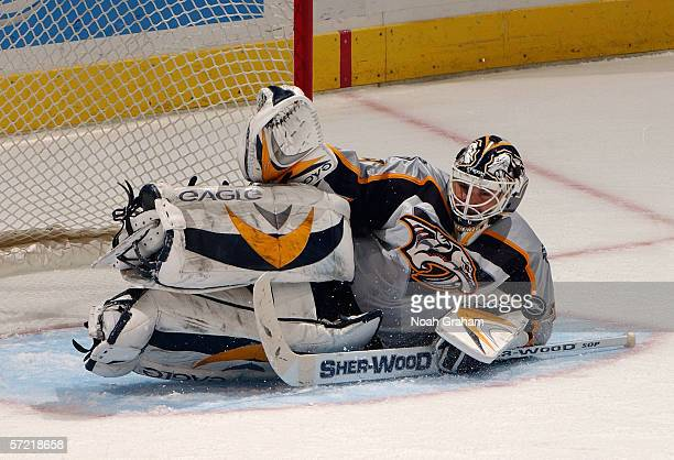Goaltender Tomas Vokoun of the Nashville Predators stacks the leg pads for the save against the Los Angeles Kings during their game on March 25, 2006...