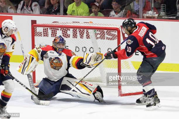 Goaltender Troy Timpano of the Erie Otters makes a glove save on a deflection from forward Jeremiah Addison of the Windsor Spitfires on May 28 2017...