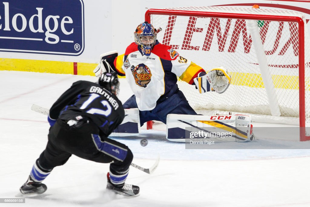 Goaltender Troy Timpano #33 of the Erie Otters makes a save against forward Julien Gauthier #12 of the Saint John Sea Dogs on May 22, 2017 during Game 4 of the Mastercard Memorial Cup at the WFCU Centre in Windsor, Ontario, Canada.