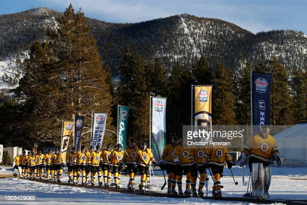 Goaltender Tuukka Rask and Patrice Bergeron of the Boston Bruins lead teammates to the ice during the 'NHL Outdoors At Lake Tahoe' against the...