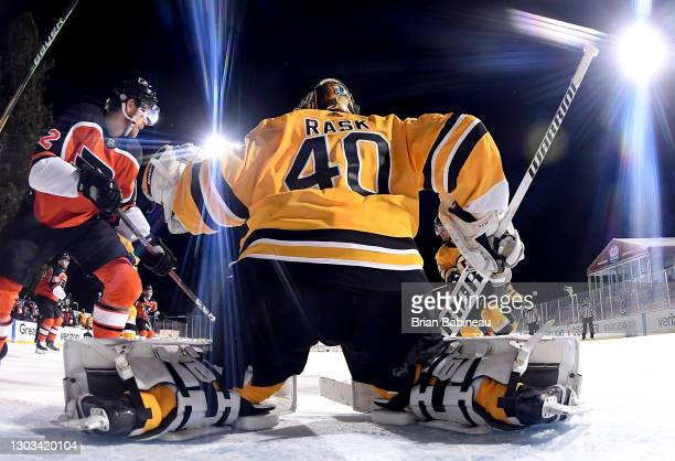 Goaltender Tuukka Rask of the Boston Bruins defends the net against the Philadelphia Flyers during the second period of the 2021 NHL Outdoors Sunday...