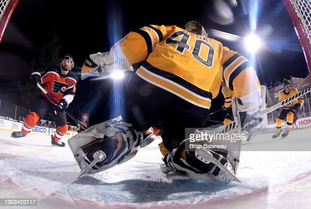 Goaltender Tuukka Rask of the Boston Bruins defends the net against Sean Couturier and the Philadelphia Flyers during the second period of the 2021...