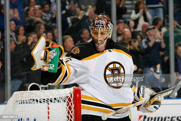 Goaltender Tuukka Rask of the Boston Bruins gets a drink during a break in the play against the Tampa Bay Lightning at the St Pete Times Forum on...