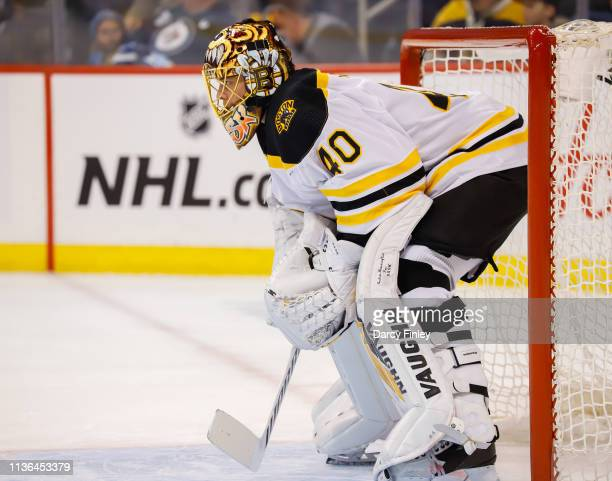 Goaltender Tuukka Rask of the Boston Bruins guards the net during first period action against the Winnipeg Jets at the Bell MTS Place on March 14...