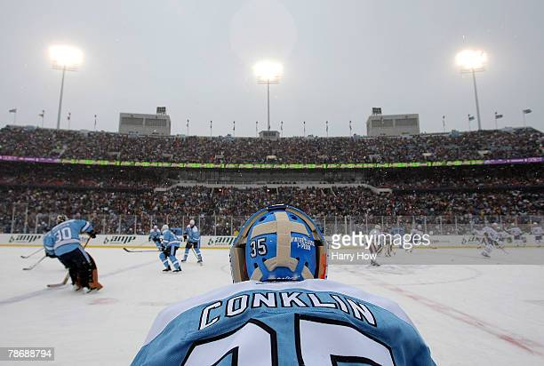 Goaltender Ty Conklin of the Pittsburgh Penguins watches his team warm up before taking on the Buffalo Sabres in the NHL Winter Classic on January 1,...