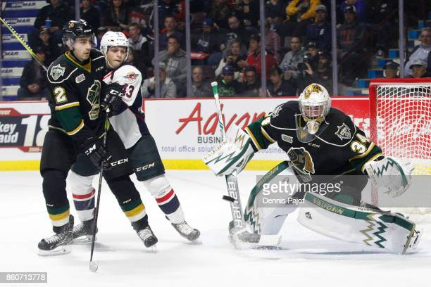 Goaltender Tyler Johnson of the London Knights makes a chest save against the Windsor Spitfires on October 12 2017 at the WFCU Centre in Windsor...