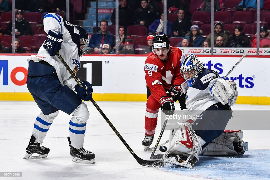 Goaltender Veini Vehvilainen #31 of Team Finland makes a pad save on Damien Riat #9 of Team Switzerland during the 2017 IIHF World Junior Championship preliminary round game at the Bell Centre on December 31, 2016 in Montreal, Quebec, Canada. Team Finland defeated Team Switzerland 2-0.