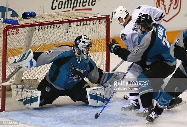 Goaltender Vesa Toskala of the San Jose Sharks makes a kick save as Ethan Moreau of the Edmonton Oilers skates in in game one of the Western...