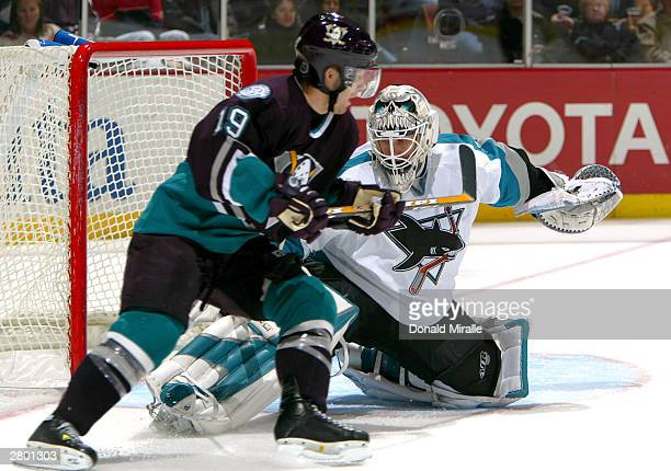 Goaltender Vesa Toskala of the San Jose Sharks makes a save against the shot of Andy McDonald of the Anaheim Mighty Ducks during the 2nd period of...