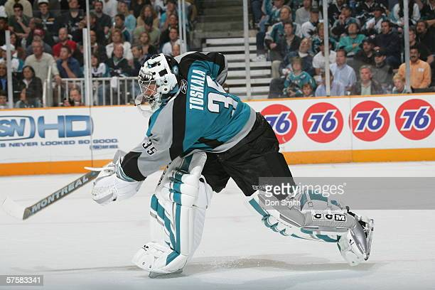 Goaltender Vesa Toskala of the San Jose Sharks shoots the puck up ice during Game 2 of the Western Conference Semifinals against the Edmonton Oilers...