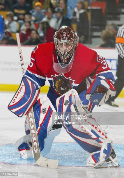 Goaltender Yann Danis of the Hamilton Bulldogs follows the play against the Manitoba Moose at the Copps Coliseum on October 17, 2004 in Hamilton,...