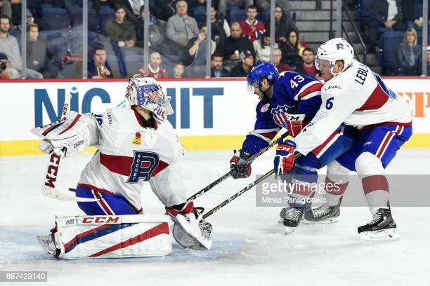 Goaltender Zachary Fucale makes a save on Colin Blackwell of the Rochester Americans while teammate Stefan Leblanc of the Laval Rocket defends during...