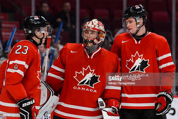 Goaltender Zachary Fucale of Team Canada speaks with teammates Sam Reinhart and Samuel Morin during the 2015 IIHF World Junior Hockey Championship...