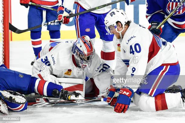 Goaltender Zachary Fucale of the Laval Rocket covers the puck in front of teammate Matt Taormina against the Rochester Americans during the AHL game...