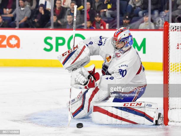Goaltender Zachary Fucale of the Laval Rocket plays the puck after making a save against the Binghamton Devils during the AHL game at Place Bell on...