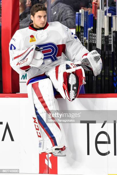 Goaltender Zachary Fucale of the Laval Rocket sits on the boards as he prepares to play against the Binghamton Devils during the AHL game at Place...