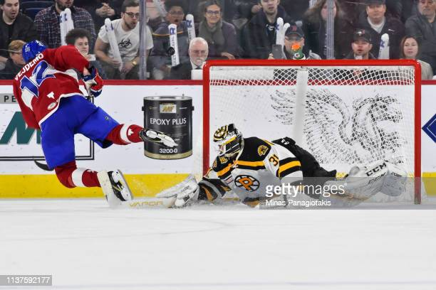 Goaltender Zane McIntyre of the Providence Bruins makes a save on Lukas Vejdemo of the Laval Rocket in a shootout during the AHL game at Place Bell...