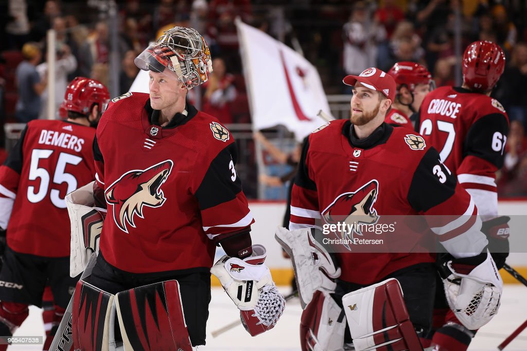 Goaltenders Antti Raanta #32 and Scott Wedgewood #31 of the Arizona Coyotes skate off the ice following the NHL game against the Nashville Predators at Gila River Arena on January 4, 2018 in Glendale, Arizona. The Coyotes defeated the Predators 3-2 in overtime.