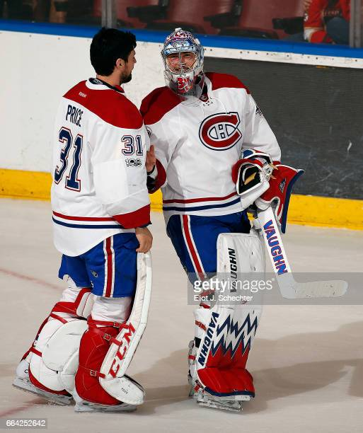 Goaltenders Charlie Lindgren and Carey Price of the Montreal Canadiens celebrates their win 41 against the Florida Panthers the BBT Center on April 3...