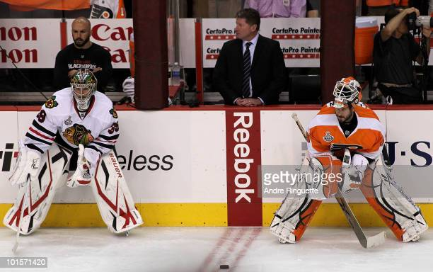 Goaltenders Cristobal Huet of the Chicago Blackhawks and Michael Leighton of the Philadelphia Flyers stand on the ice during warmups in Game Three of...