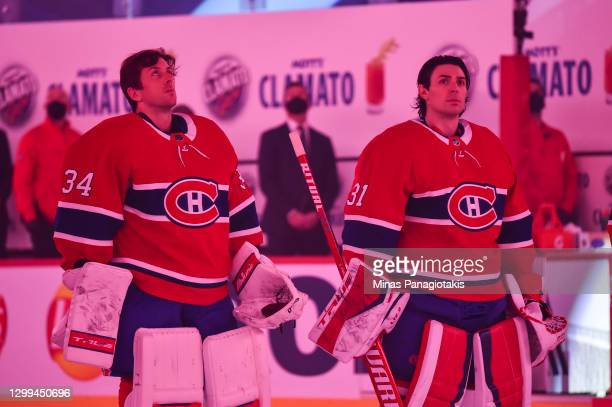 Goaltenders Jake Allen and Carey Price of the Montreal Canadiens look on during the pre-game ceremony prior to the home opening game against the...