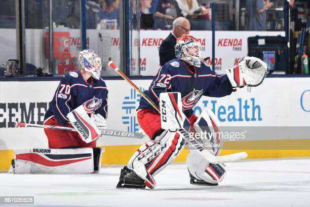 Goaltenders Joonas Korpisalo and Sergei Bobrovsky of the Columbus Blue Jackets warm up prior to a game against the New York Rangers on October 13...