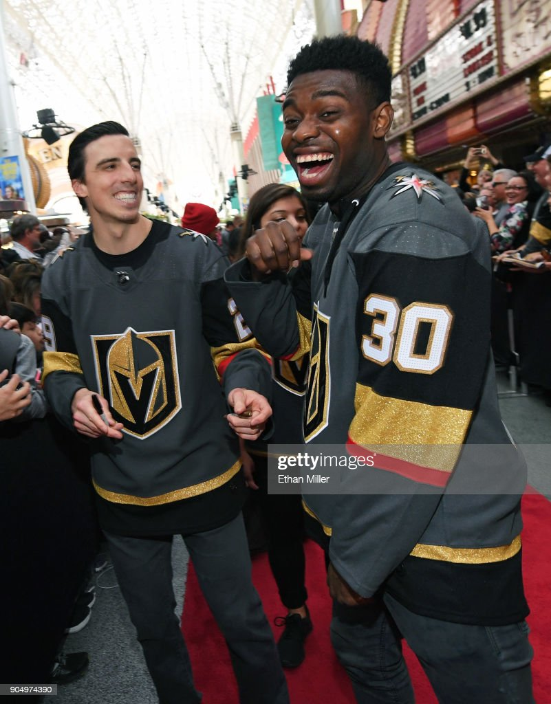 Goaltenders Marc-Andre Fleury #29 and Malcolm Subban #30 of the Vegas Golden Knights laugh as they sign autographs for fans on a red carpet during the Vegas Golden Knights Fan Fest at the Fremont Street Experience on January 14, 2018 in Las Vegas, Nevada.