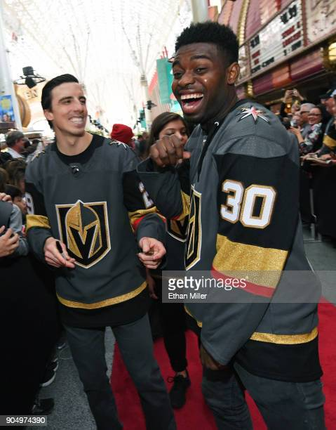 Goaltenders MarcAndre Fleury and Malcolm Subban of the Vegas Golden Knights laugh as they sign autographs for fans on a red carpet during the Vegas...