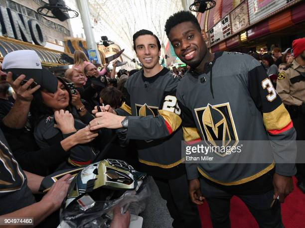 Goaltenders MarcAndre Fleury and Malcolm Subban of the Vegas Golden Knights pose as they sign autographs for fans on a red carpet during the Vegas...